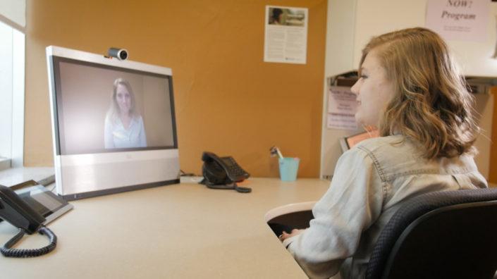 psychologist at computer